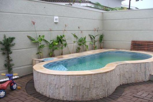 Modelos de casas pequenas com piscinas fotos for Hacer piscina climatizada en casa